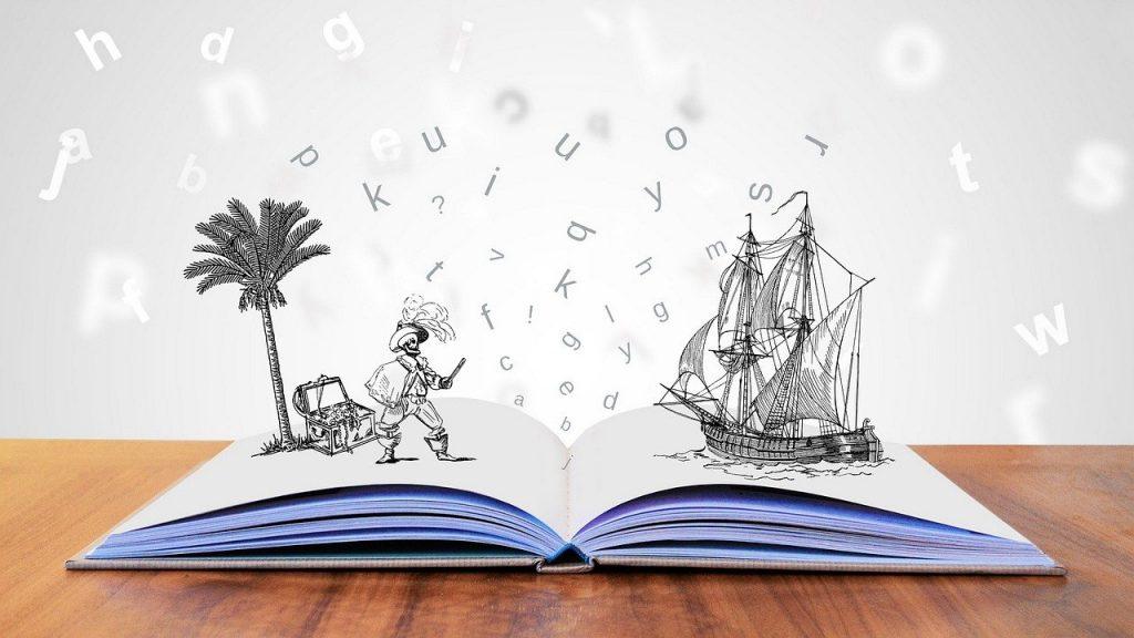 Libro aperto con immagini di un pirata e di una nave che spuntano dalle pagine. Promozione della lettura